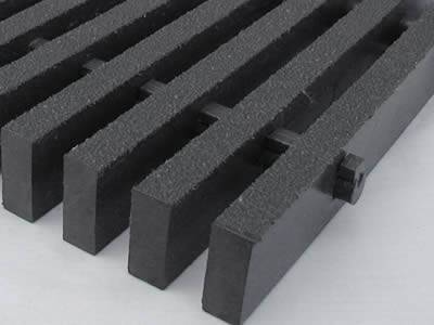 One piece of pultruded high load capacity fiberglass grating in dark gray.