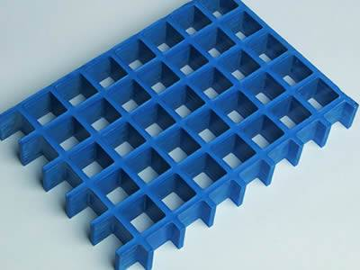 One piece of molded fiberglass grating in blue.