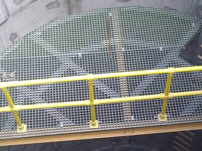 It shows that inside the cooling tower, there is FRP grating flooring installed with handrails.