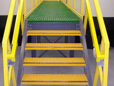 It shows that one yellow stair installed with yellow handrails.