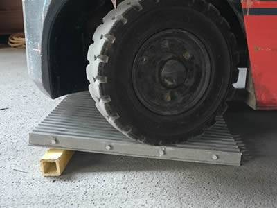It shows one truck wheel is pressing on the pultruded heavy duty fiberglass grating.
