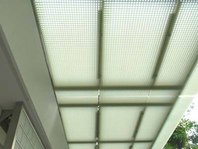 There is one molded fiberglass grating eave with light green colour outside the room.