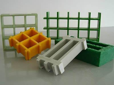 There are five pieces of molded FRP gratings on the table, and they differentiate with each other in colours and sizes.