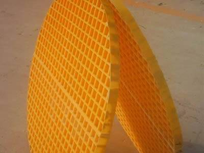 There are two pieces of round molded FRP gratings with same sizes on the ground.