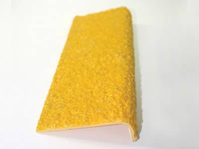 It is one yellow stair tread cover with gritted surface.