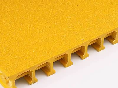 It shows one yellow pultruded FRP grating with covered gritted surface.