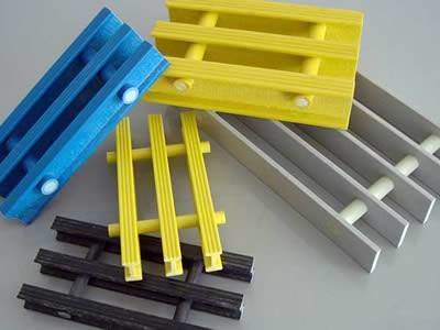 There are five pultruded fiberglass gratings shown to us, the colours are blue, yellow, light gray and black.