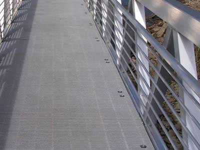 It show that the fiberglass pultruded gratings are installed as walkways near the decking.