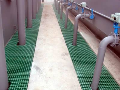 It shows that several green molded GRP grating are installed around the tubes for large facility.