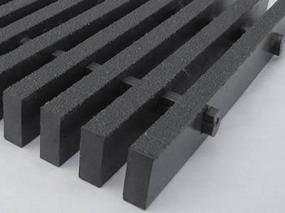 This is heavy load pultruded fiberglass grating in dark gray.
