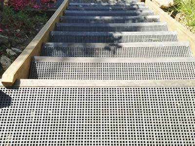 It shows that one stair tread is fabricated with micro mesh gratings.