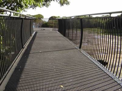 The picture shows that in a park, the passage is fabricated with mini mesh fiberglass grating.