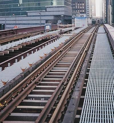 Next to the railway tracks, there are gray pultruded FRP gratings.