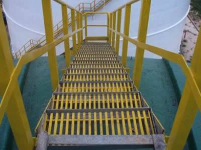 There are yellow pultruded fiberglass gratings installed with handrails forming the stairs for cooling tower.