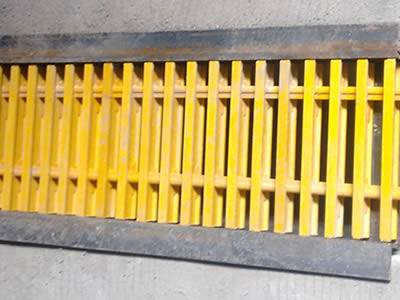 It shows that above one trench drain, the yellow pultruded fiberglass grating is installed.