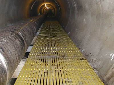 It shows that inside the tunnel, there are yellow pultruded fiberglass gratings.